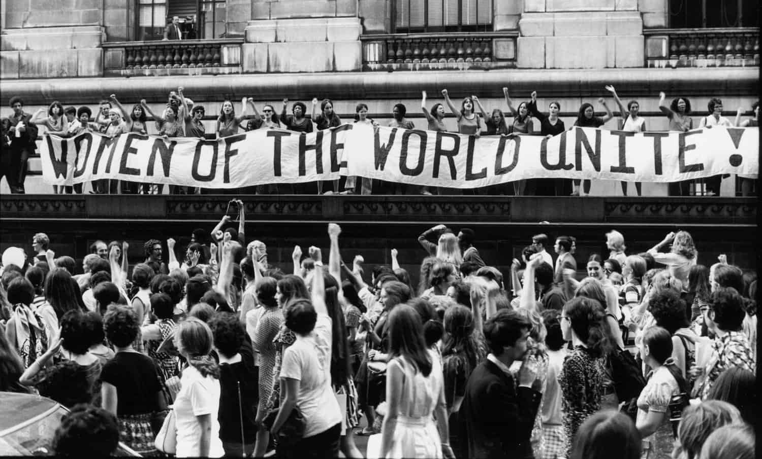 To commemorate the 50th anniversary of Women's Suffrage in the United States, record numbers of women march along 5th Avenue, past a banner that reads ''Women of the World Unite!', New York, New York, August 26, 1970. (Photo by Fred W. McDarrah/Getty Images)