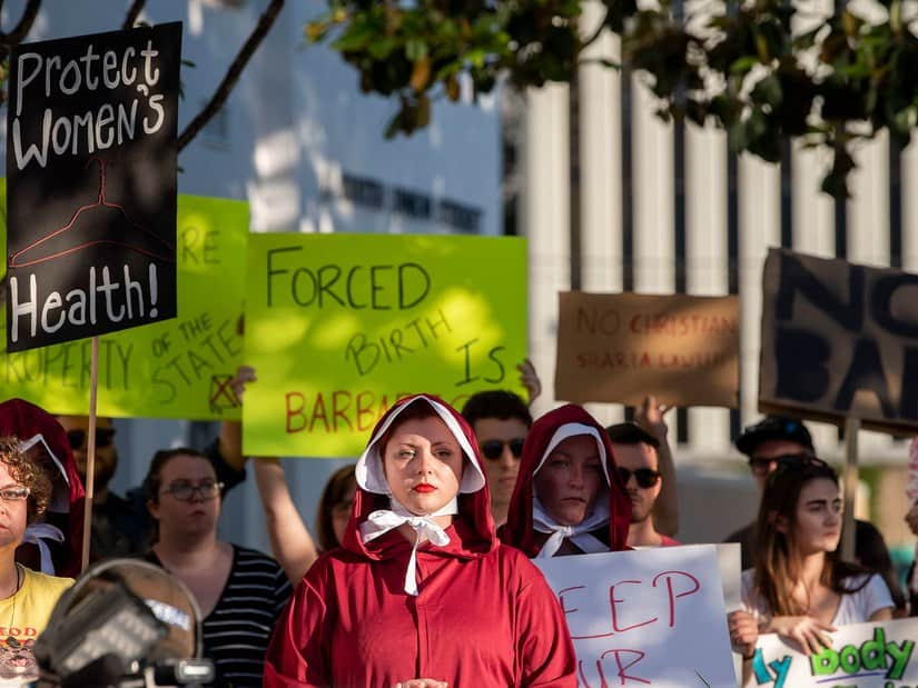 Pro-choice advocates wore the attire of women in Margaret Atwood's Handmaid's Tale novel while protesting Alabama's new abortion ban bill.